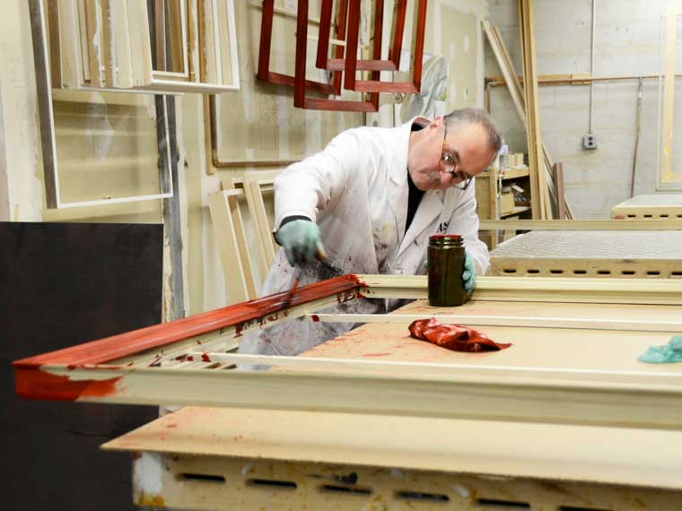 Mark LeSaffre hand finishing custom picture frames