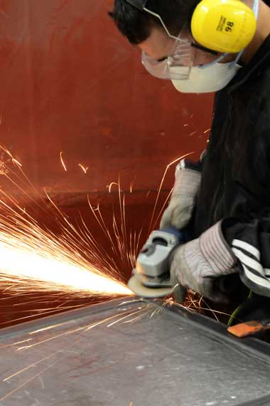 craftsman grinding welded steel picture frame